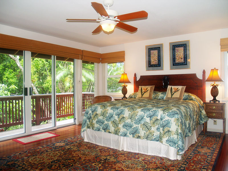 The master suite is roomy,  has a private bath and has a view of the river.