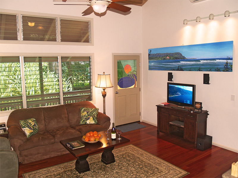 The comfortable living room features a media center including  iPod dock, Cable TV, DVD & CD player.